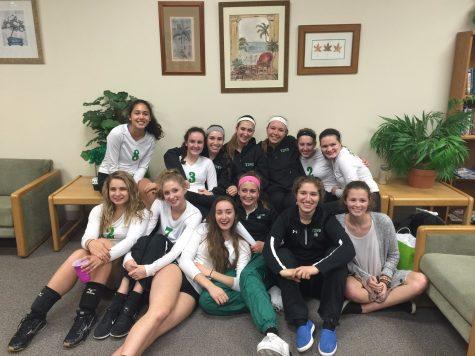 Senior girls' volleyball players celebrate final game of the regular season