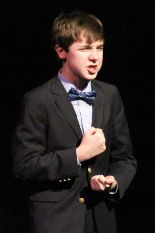 David Hansen, sophomore, performing a comedic piece he wrote himself at fine arts week.