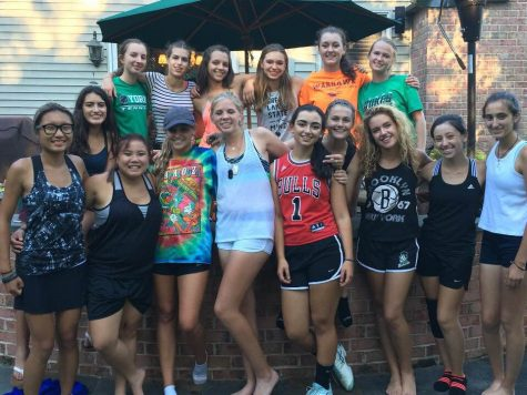 Girls Tennis Varsity Team at their first pasta party of the season