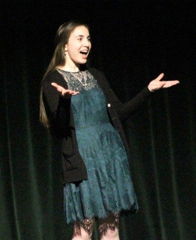 Senior Camille Butler performing at the 2015 fine arts week speech team performance.