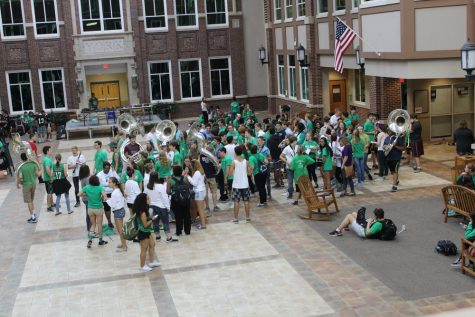 Marching band begins their march through the school in the commons during 5th period