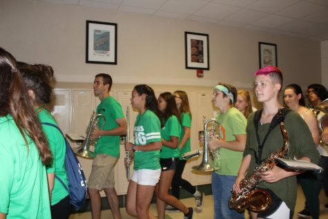 The marching band ends their march through the school on the first floor