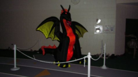 A fire breathing dragon greets students at the entrance to the field house