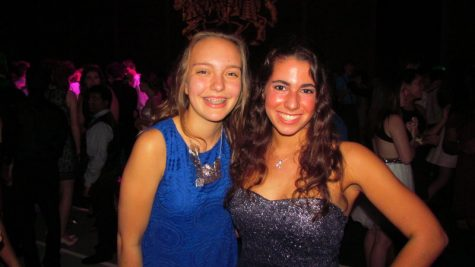 Student council Maddie Small and __ celebrate the week they helped to organize at the dance