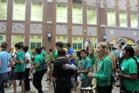 After the marching band performs the fight song in the commons, they march to the second floor