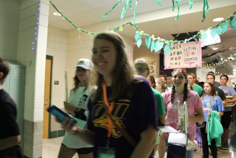 Alumni Kat Lothian revisits the band to march with them in the midst homecoming festivities