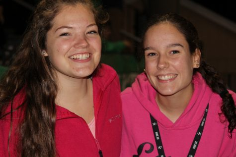 Juniors Danielle Fite and Kate Mueller at the game wearing pink for a cause.