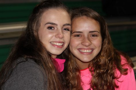 Juniors Ella Glabus and Lauren Steck watch the team play an amazing game.