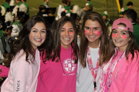 Sophomores (from left to right) Kendall Vorel, Allison Naples, Allie Pastuovic, and Libby Wagner wearing pink face paint to support breast cancer awareness at the game.