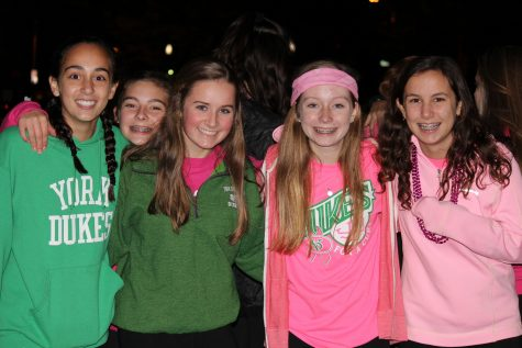 York students in pink and green entering the stadium to watch their team take on Proviso West.