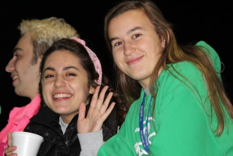 Junior Carina Kanzler and senior Andrea Shumaker sip hot chocolate at the coldest game of the season.