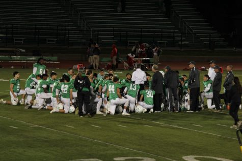 The team gathers after the game.