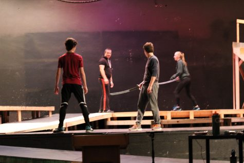 Sam Griffin (junior) and Erik Martenson (senior) receive instruction from fight choreographer Orion Couling, along with help from assistant director Maggie Patchett.