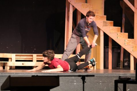 Romeo drags Tybalt away as he lunges for a sword.