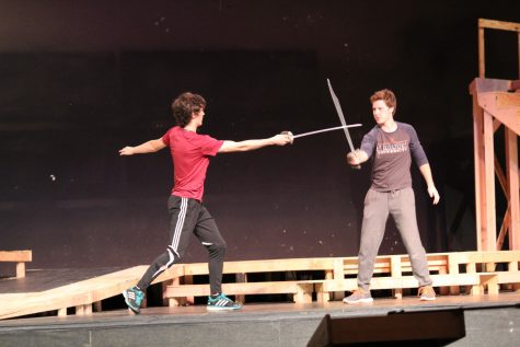 Romeo defends a hit from Tybalt, played by Erik Martenson (senior) and Sam Griffin (junior).