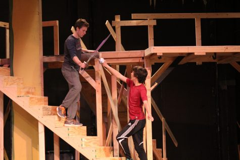 Tybalt drives Romeo up the staircase to the balcony of the Capulet household.