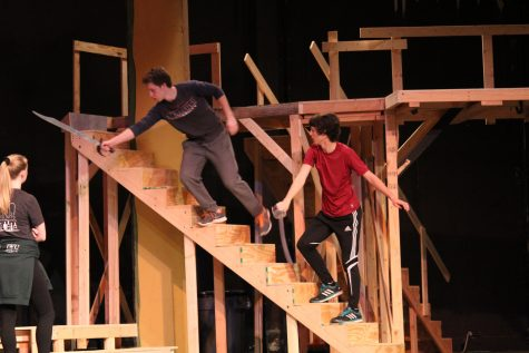 Romeo lunges off the balcony to escape from Tybalt as he draws nearer.
