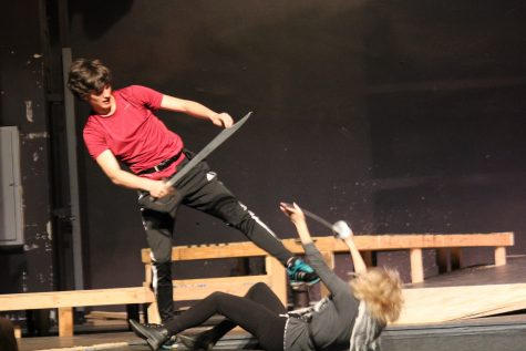 Tybalt kicks Mercutio to the ground.