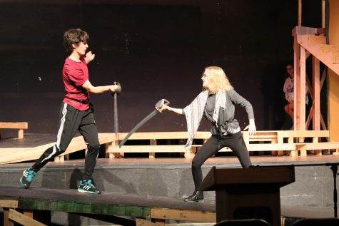 Tybalt and Mercutio (played by senior Tatum Langely) duel on a ramp at the front of the stage.