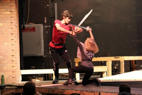 Tybalt and Mercutio, played by Sam Griffin (junior) and Tatum Langley (senior), clash swords in an intense duel.