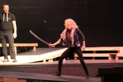 Mercutio stands with her sword prepared for Tybalt.
