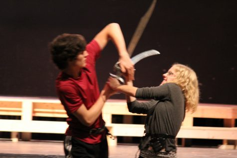 Mercutio and Tybalt grapple as the drama heightens, reaching the end of their fight.