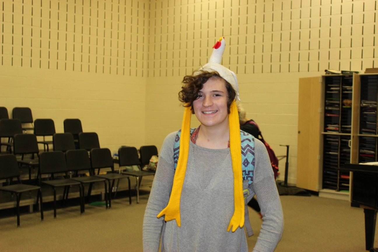 Junior Eileen King shows her excitement for Halloween by wearing a chicken hat to school.