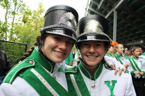 Raindrops fall on the hats of marching band friends Lindsay Mauch (sophomore) and Olivia Braun (sophomore).