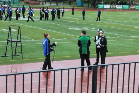 A drum major from Maine East talks with York Drum majors before the visiting school begins their set.