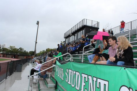 Maine East watches their hosts take the field along with York students who came to support their peers.