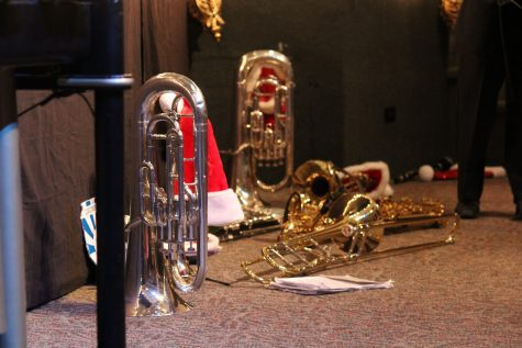 A Santa hat sits among a group of Symphonic Band instruments.