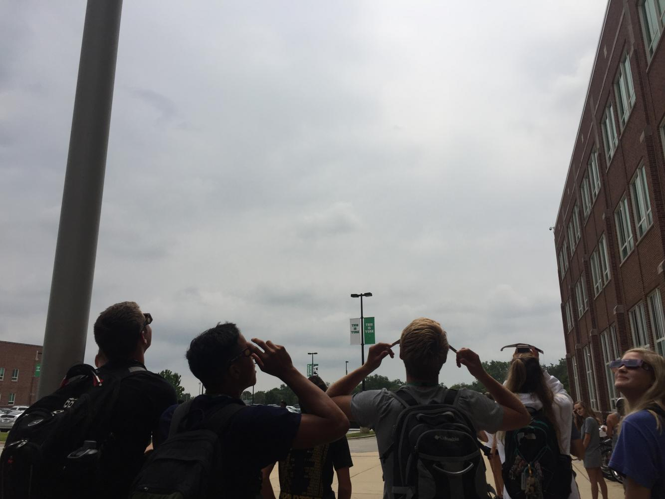 Clouds block the students' view of the solar eclipse during 6th period.