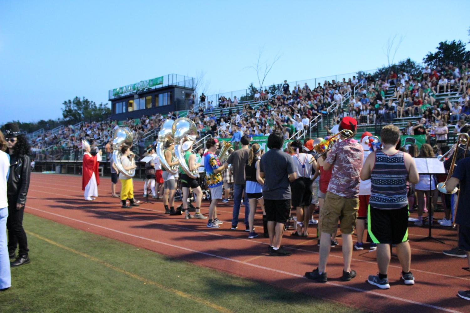 The marching band pumps up the crowd with