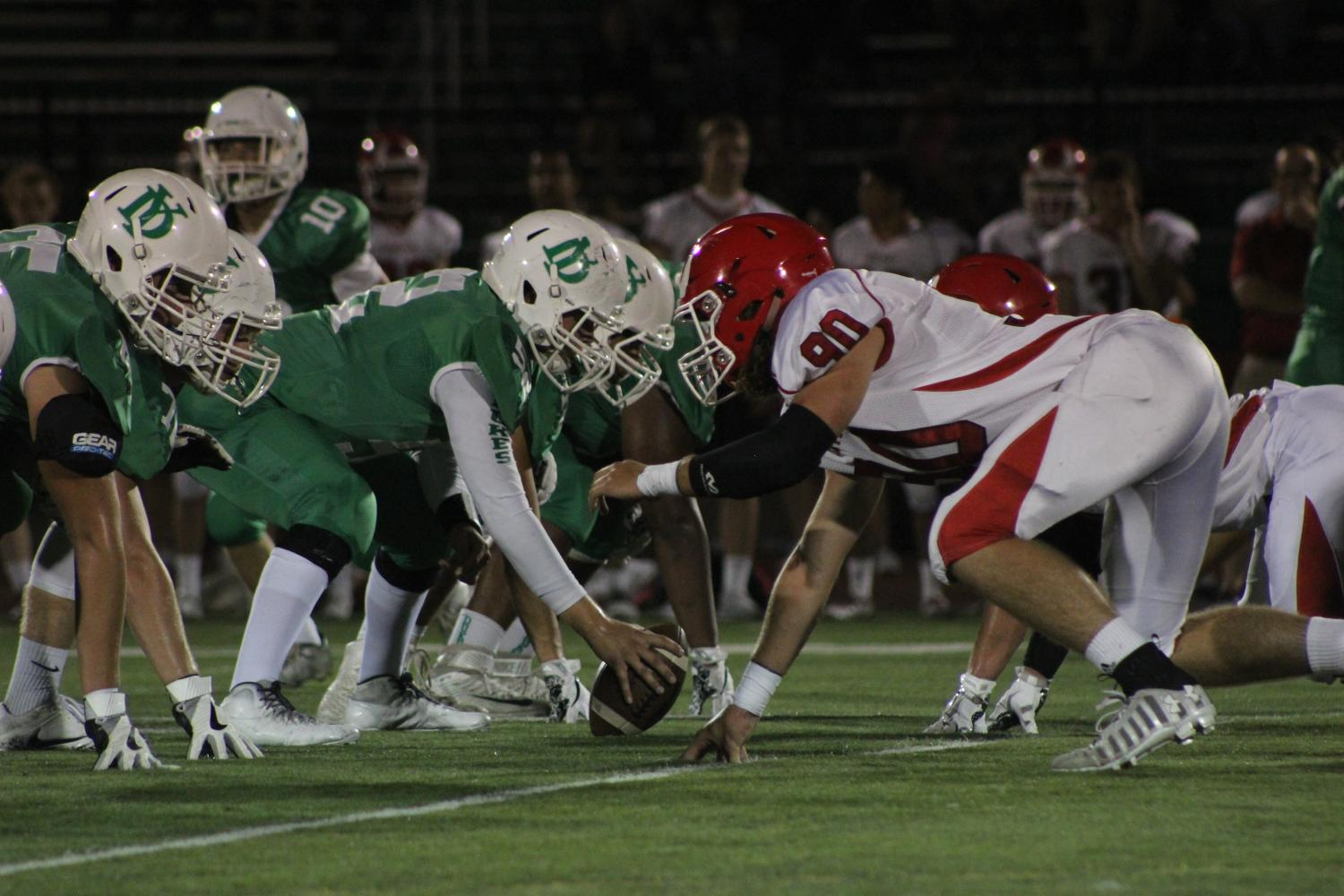 York High School and Hinsdale Central get in their positions for the next line of scrimmage at the Homecoming football game. Fri., Sept. 22, 2017