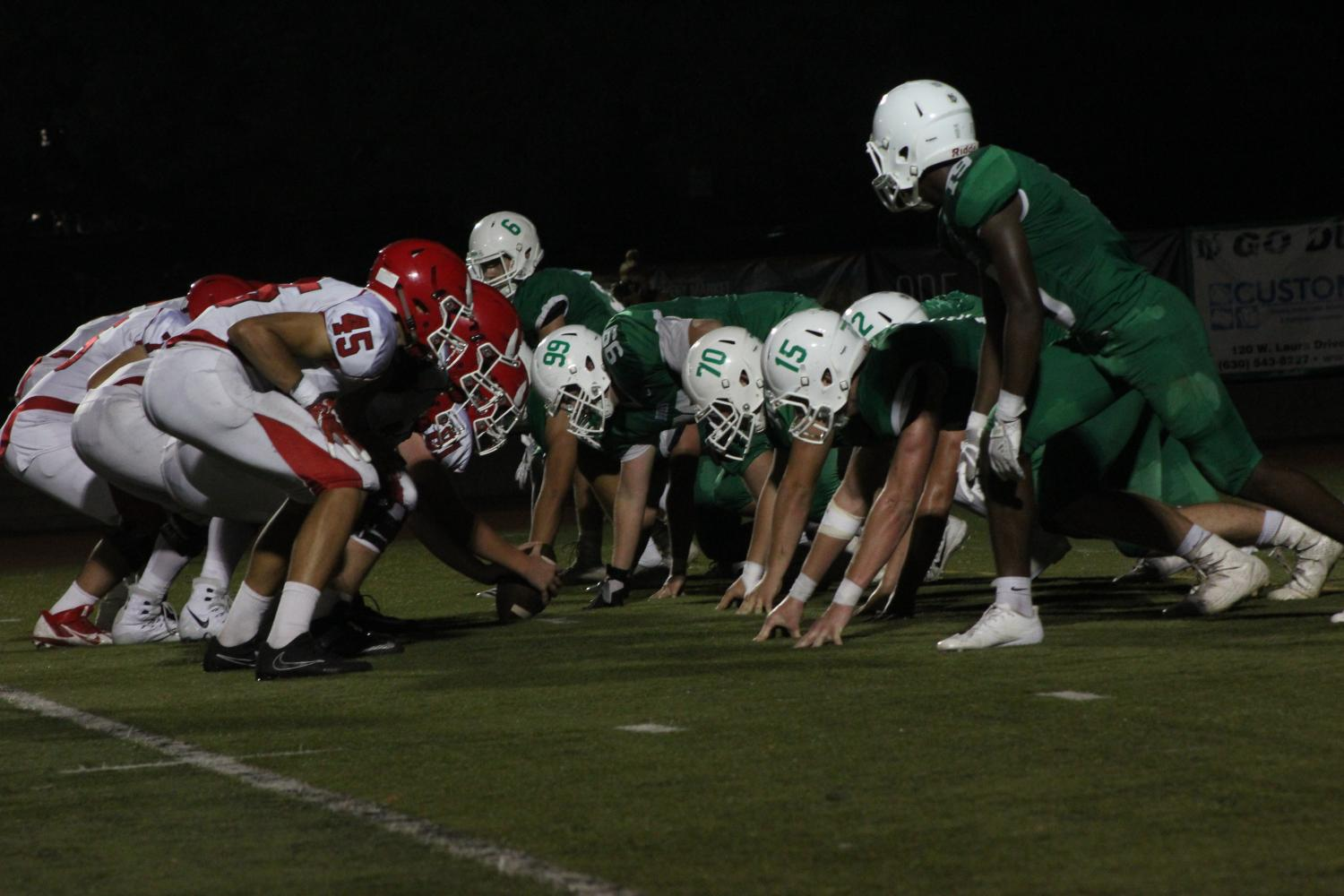 York High School and Hinsdale Central position themselves for a line of scrimmage at the Homecoming football game. Fri., Sept. 22, 2017