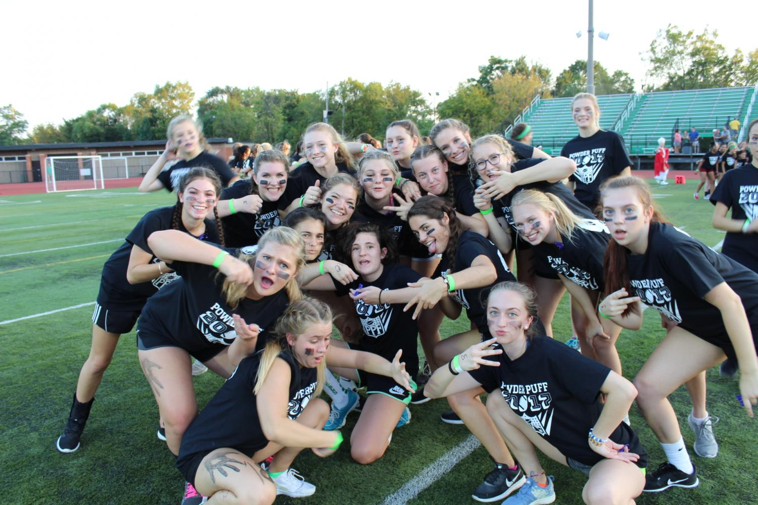 Seniors+pose+for+a+picture+before+the+2017+Powder+Puff+game+begins.