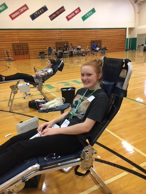 Senior Lauren Gould smiles as she prepare to donate blood for the third time at the blood drive. Thurs., Oct 19, 2017