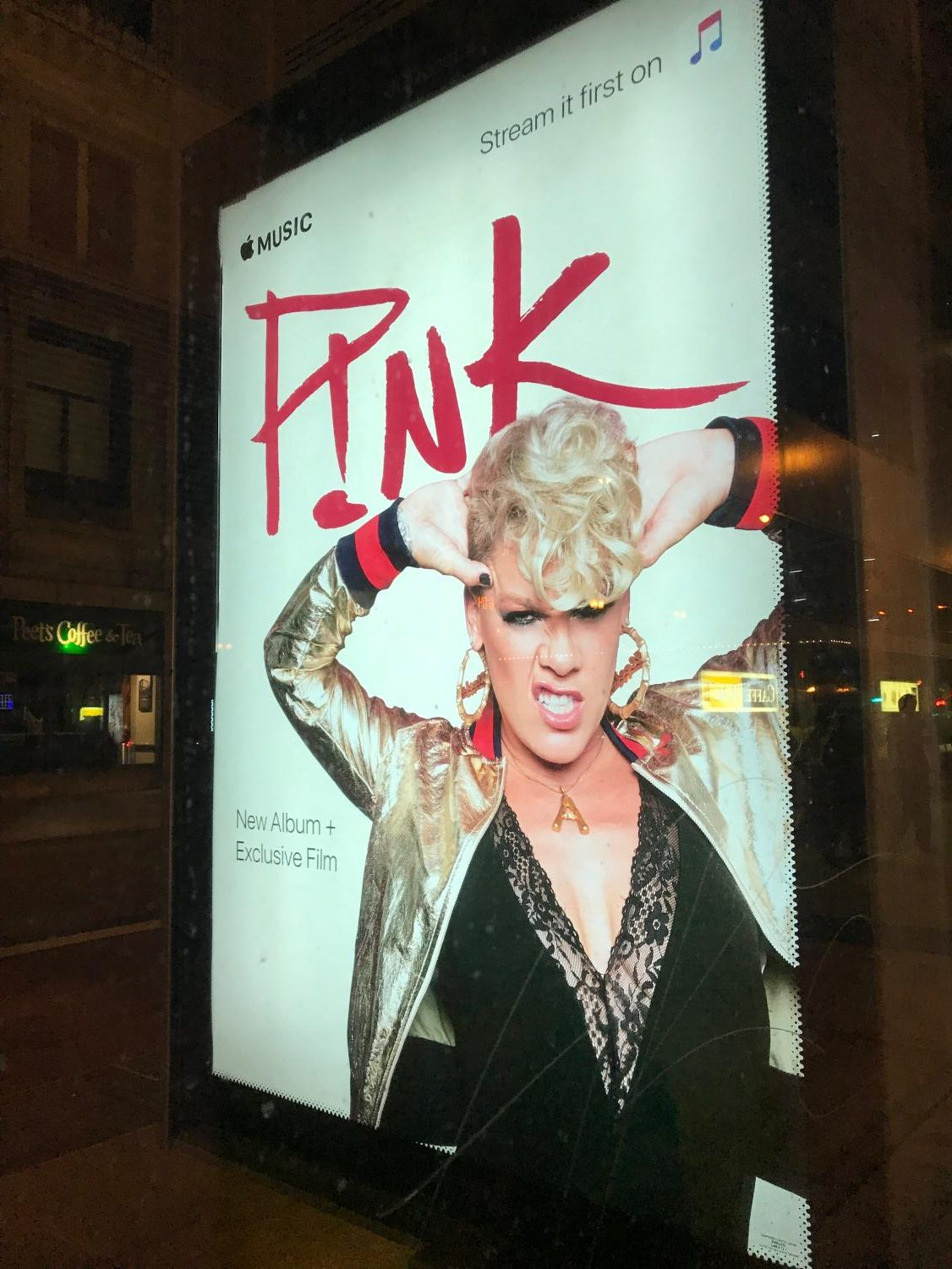 Apple Music displays an advertisement to buy P!nk's new album,