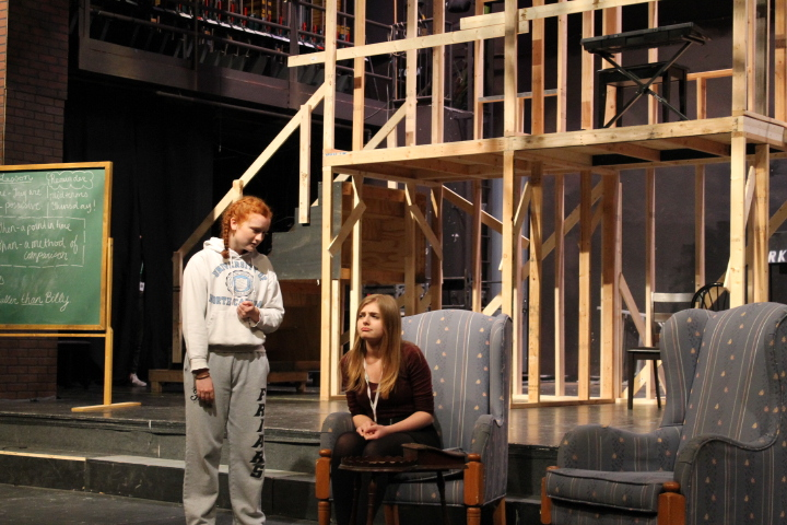 Junior Bridey Costello and Sophomore Emily Walker performing the first scene of the second act at the Tilford House.