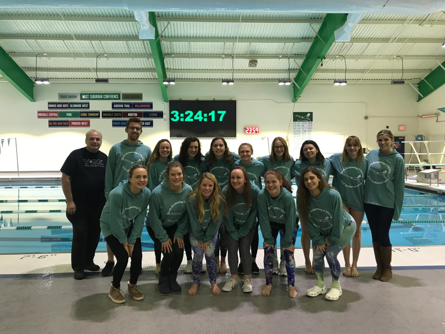 The Lady Dukes Swim and Dive show their team spirit in matching sweatshirts. Fri. Nov. 10, 2017.