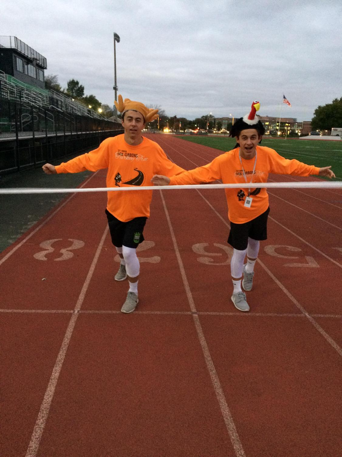 Brothers Joe Chornij (senior) and Steve Chornij (sophomore)  cross the finish line  to win the turkey trot and  the costume contest
