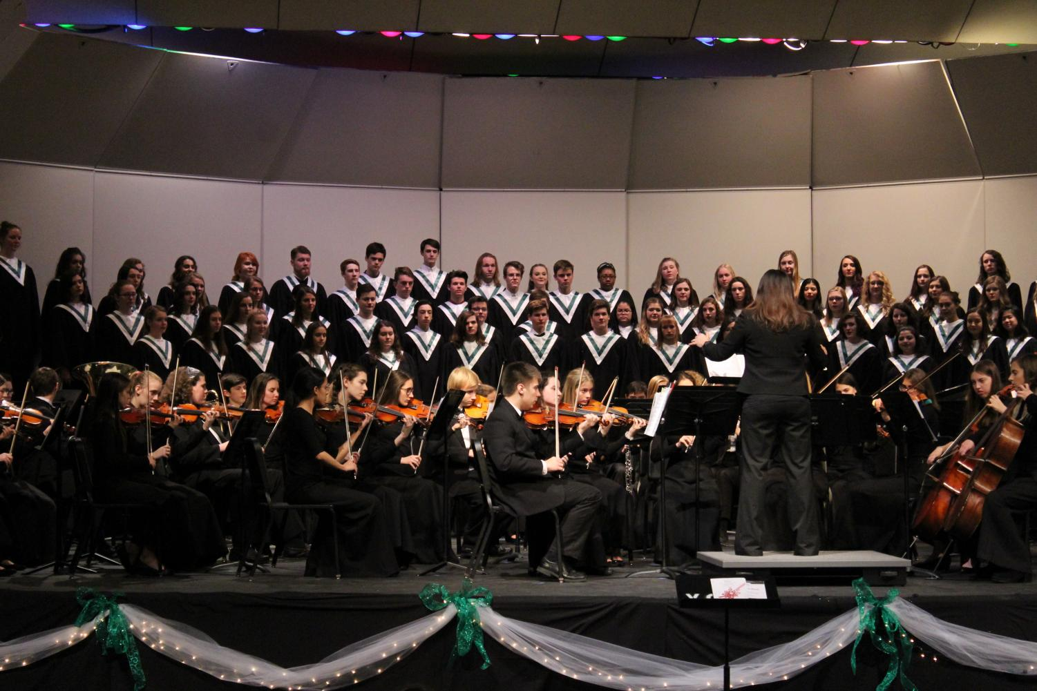 Choir director Rebecca Marianetti conducts the full orchestra along as the choir sings the finale of the night,