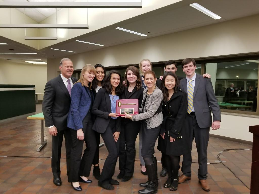 York Law Team poses with the competition facilitators after being awarded second place. at the Skokie mock trial competition on Jan. 25, 2017.
