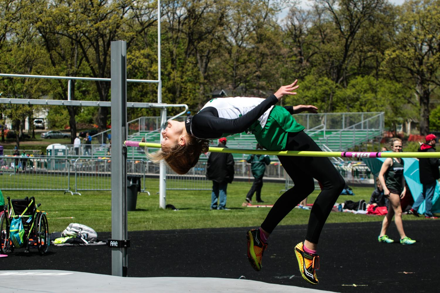 Junior, Nicki Anderson, soars high above the high jump bar during the West Suburban Conference Meet, finishing third for the frosh/soph team. May 3, 2017.