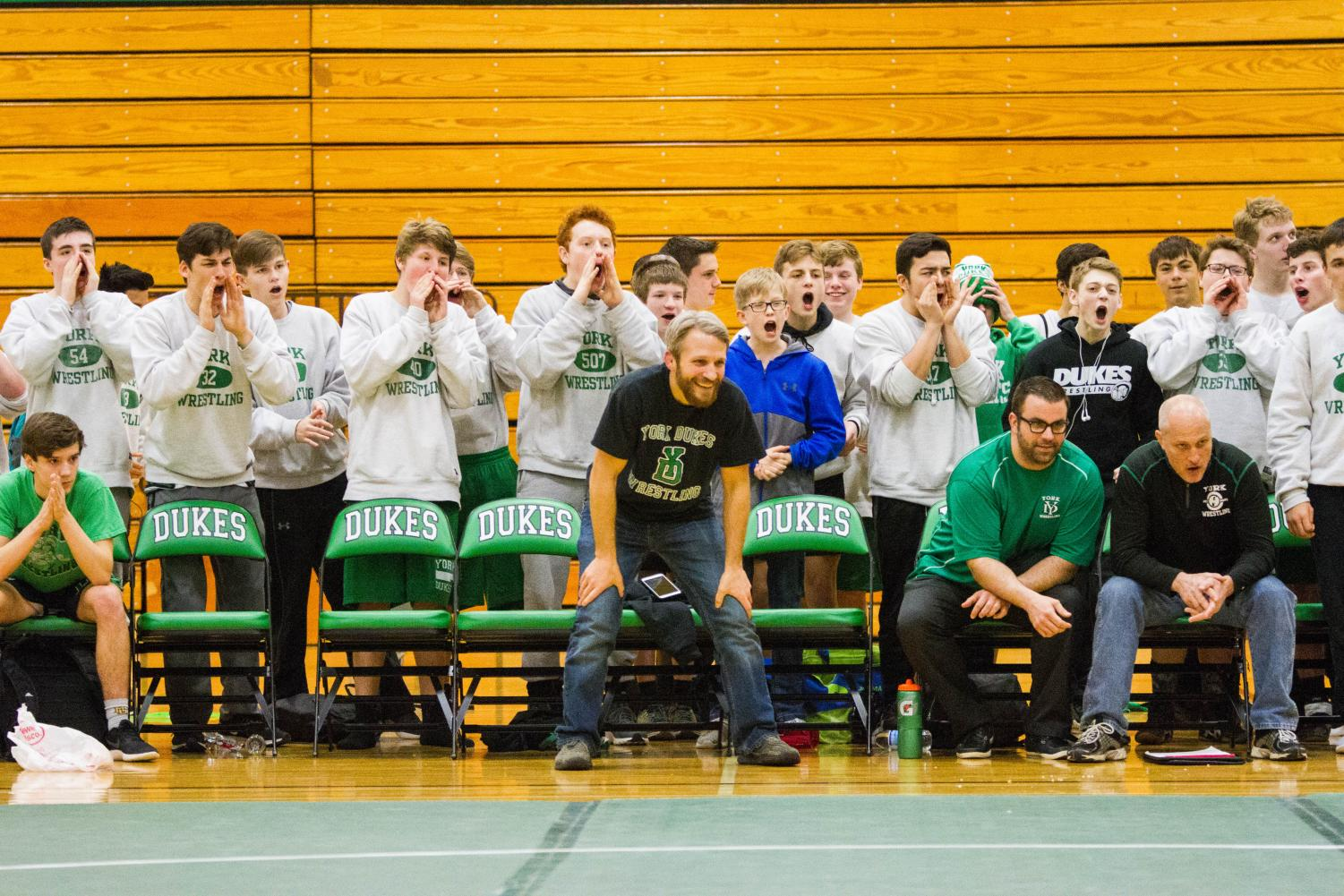 All levels of dukes wrestling gather to cheer on their final wrestler for the night.
