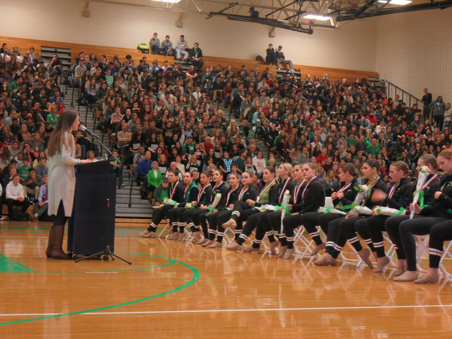 Coach Kristen Baron honors the poms team at the pep rally celebrating their 2018 state championship. Feb. 2, 2018.