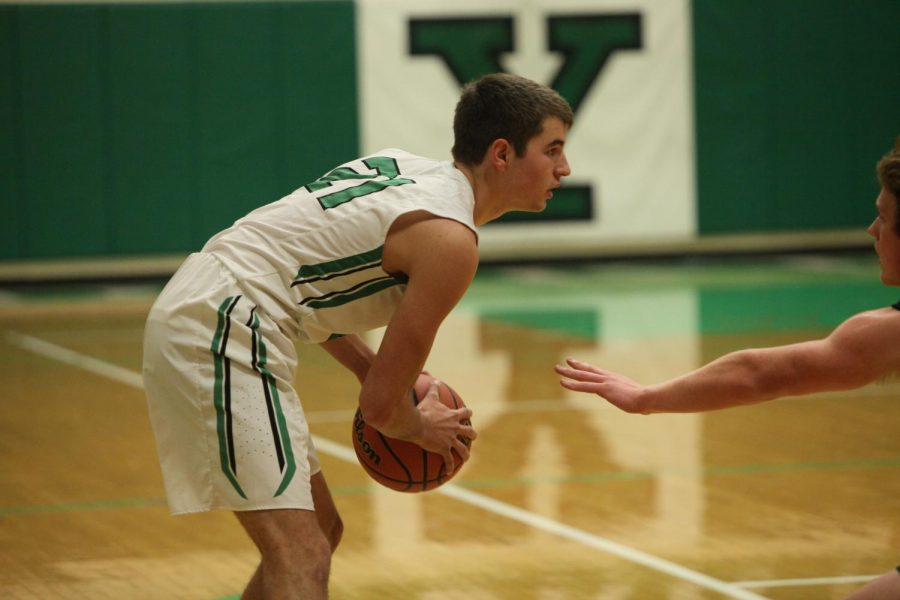 Senior Nate Lyons looks to make a pass in a home game