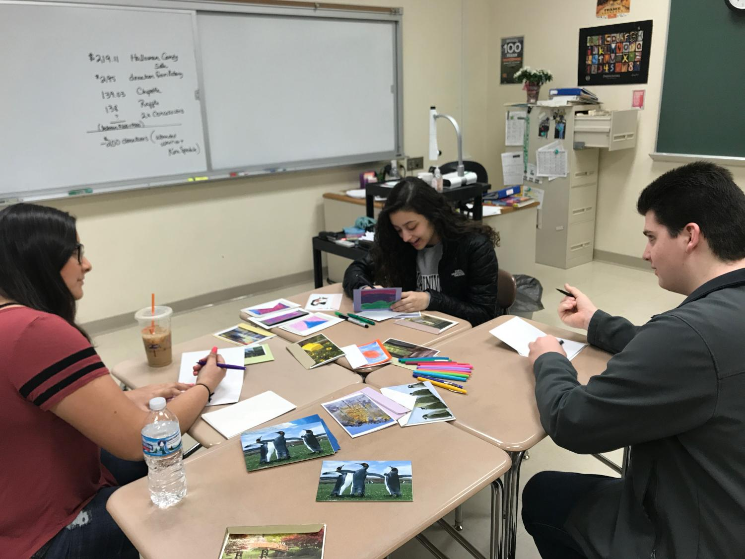 Interact Club President, William Parpan, writes encouraging letters to Parkland students with fellow members.