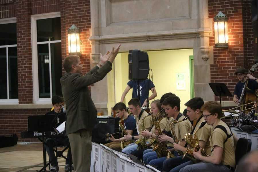 Mr. Riddle conducts jazz ensemble during the 2018 Valentine's Day concert.