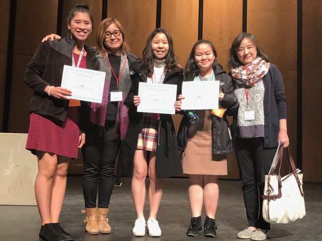 Chinese+teachers+Mrs.+Li+and+Mrs.+Chou+stand+proudly+with+their+students+after+the+results+have+been+announced.+April.+21%2C+2018.